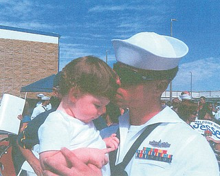 Jason Davis is reunited with his son Jason Davis Jr. after a four-month deployment with the U.S. Navy overseas. They reunited in California and are originally from Austintown. Picture sent in by wife Jana Davis of San Diego, Calif., and mother-in-law Katie Davis of Youngstown.