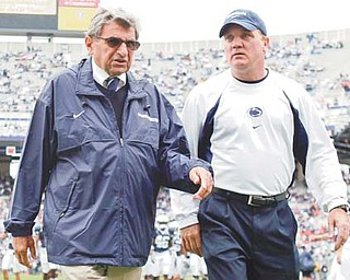 Penn State coach Joe Paterno walks onto the field with assistant coach Tom Bradley before a game against Syracuse. Penn State trustees chose Bradley as interim head coach for the remainder of the season in the wake of Wednesday's firing of Paterno and university president Graham Spanier amid the growing furor over how they handled sex abuse allegations against a retired assistant coach.