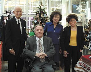 Steering committee members for the 41st Annual American Holiday preview party at the Butler Institute of American Art are, from left, C. Gilbert James, John MacIntosh, Florence Wang and Camilla Geordan.