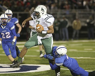 ROBERT  K.  YOSAY  | THE VINDICATOR --..One Legged tackle by Mitch Shahaden as he brings down the QB for Malvern Shawn Ball during first quarter action #22 Jon Timko looks on..Regional quarter final at Western Reserve Stadium - Western Reserve Blue Devils  VS   Malvern Hornets at Louisville.--30-..(AP Photo/The Vindicator, Robert K. Yosay)