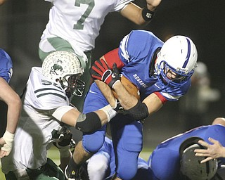 ROBERT  K.  YOSAY  | THE VINDICATOR --..Donnie Bolton for Western Reserve drives thru the line for a first down as #52  Logan Sellers and #7 Shawn Ball for Malvern attempt to stop him during first quarter action in Louisville..Regional quarter final at Western Reserve Stadium - Western Reserve Blue Devils  VS   Malvern Hornets at Louisville.--30-..(AP Photo/The Vindicator, Robert K. Yosay)