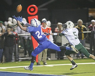 ROBERT  K.  YOSAY  | THE VINDICATOR --..Just out of reach #24 Thomas Benyo  reaches for a TD pass as he beats #5 AAron  Enold during second quarter action - the  ball was over thrown..Regional quarter final at Western Reserve Stadium - Western Reserve Blue Devils  VS   Malvern Hornets at Louisville.--30-..(AP Photo/The Vindicator, Robert K. Yosay)