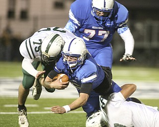 ROBERT  K.  YOSAY  | THE VINDICATOR --..Jeff Clegg is stopped after getting afirst down in the first drive in the third quarter  by #7 Shawn Ball and 75 Tyler Litten -  behind them #77   Aaron Halls - ..Regional quarter final at Western Reserve Stadium - Western Reserve Blue Devils  VS   Malvern Hornets at Louisville.--30-..(AP Photo/The Vindicator, Robert K. Yosay)