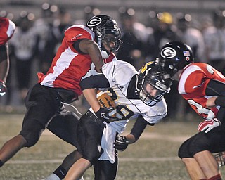 Black River running back Zach Marror #28 is tackled by Girard defenders #8 (name not on roster) and #33 James Cupan.