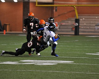 #2 WR Darien Townsend scrambles to break away from Shadyside DB #20 Cody Hudson as Shadyside LB #43 DJ Shoemaker and LB #7 Levi Spencer move in for assistance.