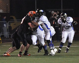 #58 OL Brandon Krock of Shadyside and #17 DE Kaevon Green battle at the line of scrimmage with #52 LB Nick Rios of YCA in the background..