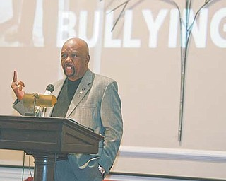 Bob Dean, Warren city councilman at-large and council president-elect, tells an audience that school administrators and elected officials must ensure that bullying doesn't interfere with any student's education and ambitions. The town-hall meeting was Sunday at First Unitarian Church in Youngstown.