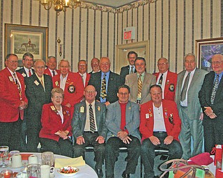 Past District Governors and spouses of District 13-D Lions Clubs had their annual banquet recently at A La Cart in Canfield. Serving as host and master of ceremonies was Past District Governor Harold Ullman of the Crestwood Lions Club. His wife, Joyce Ullman, was hostess. District 13-D comprises clubs in Mahoning, Trumbull, Portage, Stark and Columbiana counties. In front from left are Verna Williams, Warren; Harold Ullman, Crestwood; Ronald Anderson, Lisbon; and Ronald Clifton, Youngstown South Side. Second row: Donald Heldman, East Liverpool; Donald Martin, Crestwood; Ted Filmer, Canfield; Bob Whited, Austintown; Paul Metrovich, Calcutta; Jerald McCullough, Niles; Bud Jenkins, Boardman; and Bill Mundy, Lisbon. Third row: Gov. David Gauch, Crestwood; Robert Booher, Canal Fulton; Tom Kirkbride, Lisbon; Jeff Snyder, Magnolia; and Charles Allcorn, Sebring.