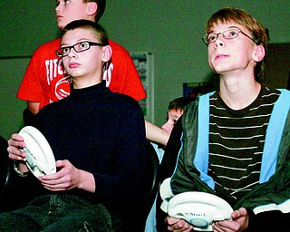 Eric Henderson, 13, and Ethan Saxey, 12, both seventh-graders, begin their competition round of Mario Kart Racing during Thursday night's fundraiser. The Honor Language Arts students organized and hosted the event to raise money for a variety of charities. Winners in the Wii competition were Jensen Hykes, Just Dance 2; Paul Gavin, boxing; Riley Terrill, Mario Kart and Evan Schobel, Wipeout.