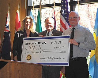 Boardman Rotary member Ted Thornton, center, presents a check to Carol Potter and Mike Schaffer of the YMCA to help fund programs for disadvantaged youths.