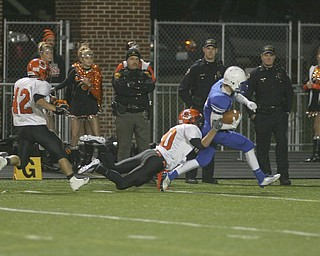ROBERT  K.  YOSAY  | THE VINDICATOR --..Regional Finals .#3 Tim Cooper carries shadyside defender #20 Cody Hudson  into the endzone after a 65 yard touchdown pass  behind them is #42 Brooks Ramsey--30-..(AP Photo/The Vindicator, Robert K. Yosay)