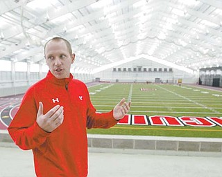 """A 300-meter track loops around the Watson and Tressel Training Site (WATTS) field with eight lanes on the straightaway and six lanes all around. """"It's the Cadillac of track surfaces,"""" says Tim Stuart, manager of facilities and programs for Youngstown State University athletics."""
