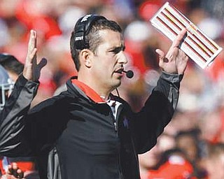 Ohio State's Luke Fickell coaches against Indiana during a Nov. 5 game in Columbus. Fickell's fate is up in the air as the Buckeyes prepare for a trip to Michigan.