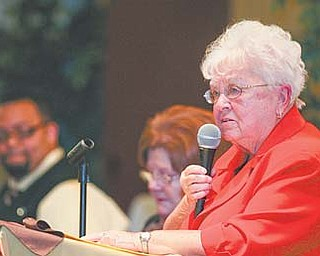 "Sister Nancy Dawson, general superior of the Ursuline Sisters of Youngstown, addresses 200 clergy, government officials and lay faith leaders at the 26th annual Mayors' Prayer Breakfast on Tuesday at Mahoning Country Club. Her theme was ""Better Together."""