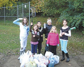 They're making a difference: The girls of Girl Scout Troop 301 have completed two of their 10 monthly community service activities in their Year of Service project. The girls, who live in Youngstown, Girard, McDonald, Canfield, Austintown, Mineral Ridge and Liberty, are excited to be helping their communities. In October, they participated in Make a Difference Day, when they collected more than 30 bags of garbage in a section of Mill Creek Park. Some of the girls also raked leaves for their neighbors who are unable to. On Nov. 5, they donated clothing to the local Goodwill for Goodwill Good Turn Day. For their December project they will adopt a local family and spend their troop savings to brighten their Christmas. From left to right are Emma Reardon, Elizabeth Neff, A.J. Neff, Kaitlyn Cefalde, Katie Samuels and Katrina Neff.