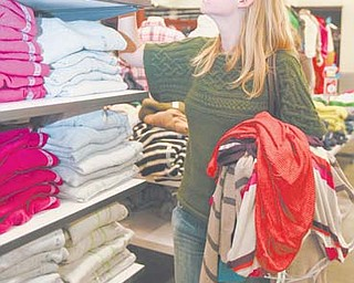 Phoebe Gordon, 24, of Columbus searches for winter clothes at Old Navy in The Shops at Boardman Park. Old Navy was open from 9 a.m. to 8 p.m. Thanksgiving Day, then reopened at midnight.