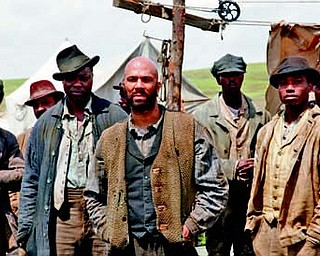 "Common, center, portrays Elam Ferguson in the original series ""Hell On Wheels,"" premiering Sunday on AMC."