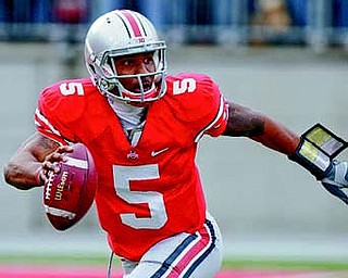 Ohio State's Braxton Miller is in action against Penn State during an NCAA college football game last week in Columbus. The Buckeyes continue their storied rivalry against Michigan on Saturday.