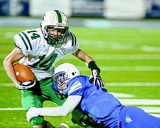 Western Reserve's Tim Cooper stops Malvern's Travis Tucci (14) during their playoff game Nov. 12 in Louisville.