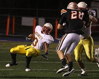FOOTBALL - (3) Roosevelt Griffin cuts hard Friday night in Uniontown. - Special to The Vindicator/Nick Mays