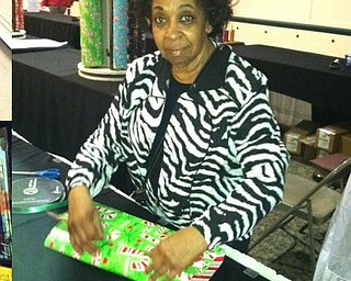 Barbara Currie wraps gifts for customers at Eastwood Mall.