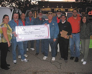 Touched by Nathan: The Valley Cruzers Car Club and their sponsors raised and presented a check for $4,000 to the Touched by Nathan Foundation, formed in 1999 for the needs of special children and their families. The Valley Cruzers have raised more than $50,000 over the past 12 years. From left to right are Leslie Joseph, Steve Bendel, Frank Imburgia, Harry Barber, Gary Monroe, Bob Brown, Steve Gorecki, Thomas John, Ken Pavalko and Melonie Yannitto.