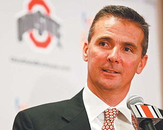 Urban Meyer, an Ashtabula native and former Florida coach, was offi cially introduced as the new head football