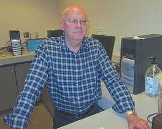 Bill Nicholas, chief appraiser with the Trumbull County Auditor's office, stands near a bank of computers at the auditor's office that are used by the public to look up property values. Nicholas says the most recent property revaluation conducted in Trumbull County provides one of the most accurate measurements of property values the county has had in close to 20 years.
