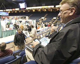 "ROBERT K. YOSAY | THE VINDICATOR..Jack Trettel Account manager with Matheson Valley out of Pittsburgh is connected as he worked the Expo - ""The YOUNG 2011 Conference and Expo Ñ the first Utica shale play conference in the state of Ohio Ñ is a dedicated B2B conference in which national and local companies can exhibit their products and interact with key players in the burgeoning Utica and Marcellus supply chain. at the Covelli Centre .. .-30"