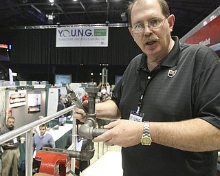 "ROBERT K. YOSAY | THE VINDICATOR..From the Plumbers and Steamfitters -  Jim Young shows some of the new equipment in use and yet some of the standard plumbing - used in well drilling - from the Plumbers and Steamfitters Union  396 495   ""The YOUNG 2011 Conference and Expo Ñ the first Utica shale play conference in the state of Ohio Ñ is a dedicated B2B conference in which national and local companies can exhibit their products and interact with key players in the burgeoning Utica and Marcellus supply chain. at the Covelli Centre .. .-30"