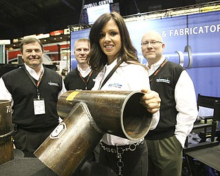"ROBERT K. YOSAY | THE VINDICATOR.. Shanon Snow, office manager for  behind her is Randy Debeul - Michael Montgomery and Ray Montgomery  ""The YOUNG 2011 Conference and Expo Ñ the first Utica shale play conference in the state of Ohio Ñ is a dedicated B2B conference in which national and local companies can exhibit their products and interact with key players in the burgeoning Utica and Marcellus supply chain. at the Covelli Centre .. .-30"