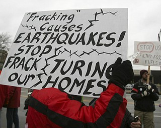 "ROBERT K. YOSAY | THE VINDICATOR..While thousands learned about the Utica Shale industry inside the Covelli Centre, about 100 anti-fracking protesters from around Ohio braved the snow and cold to tell their side of the story..""The YOUNG 2011 Conference and Expo Ñ the first Utica shale play conference in the state of Ohio Ñ is a dedicated B2B conference in which national and local companies can exhibit their products and interact with key players in the burgeoning Utica and Marcellus supply chain. at the Covelli Centre .. .-30"