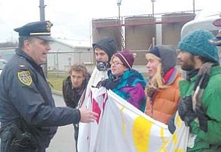 Youngstown Police Chief Rod Foley talks to environmental protesters outside the D&L Energy injection-well site on Ohio Works Drive. Police arrested the protesters Wednesday after they refused to move and allow a truck access to the site.