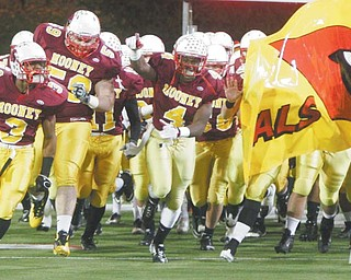 Cardinal Mooney players rush onto the field at Canton's Fawcett Stadium for the Division III regional final against Dover. The Cardinals will take the field at Fawcett for the final time this season today in the state championship game against Springfield Shawnee.
