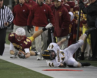 Mooney's #14 Ryan Farragher goes airborne and is pushed out of bounds by Shawnee #44 Ryan Mayfield. Youngstown Cardinal Mooney won their 8th championship as they beat the Shawnee Braves in Fawcett Stadium  21-14. (AP Photo/The Vindicator, Robert K. Yosay)