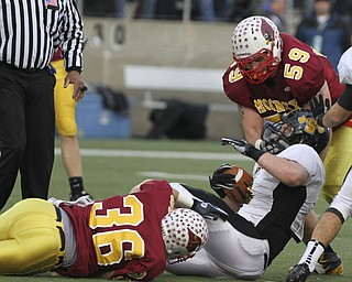 # 36 AjJ Thomas and #59 Austin Turgovich stop Shawnee #6 Alex Mccrory at the line. Youngstown Cardinal Mooney won their 8th championship as they beat the Shawnee Braves in Fawcett Stadium  21-14. (AP Photo/The Vindicator, Robert K. Yosay)