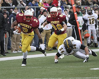 Mooney #3 Roosevelt Griffin eludes Shawnee #54 Lucas Sparks on his way to Mooney's first touchdown. Behind him is #88 Matt Pechia. Youngstown Cardinal Mooney won their 8th championship as they beat the Shawnee Braves in Fawcett Stadium  21-14. (AP Photo/The Vindicator, Robert K. Yosay)