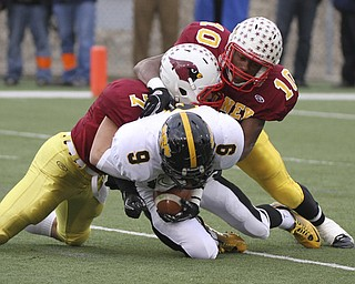 Mooneys #7 Michael Bruno and #10 Justin Ellis Moore bring down Shawnees Jordan Huggins in the backfield for a loss during first half action. Youngstown Cardinal Mooney won their 8th championship as they beat the Shawnee Braves in Fawcett Stadium  21-14. (AP Photo/The Vindicator, Robert K. Yosay)