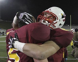 #5 JT Thiel and #8 Ryan Lanzo celebrate the championship. Youngstown Cardinal Mooney won their 8th  championship as they beat the Shawnee Braves in Fawcett Stadium  21-14. (AP Photo/The Vindicator, Robert K. Yosay)