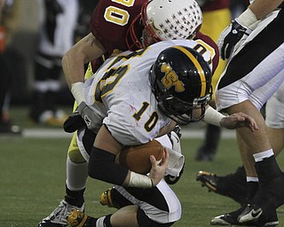 Mooneys #30 Joe Stana sacks #10 Brad Jarzab during first half action. Youngstown Cardinal Mooney won their 8th championship as they beat the Shawnee Braves in Fawcett Stadium  21-14. (AP Photo/The Vindicator, Robert K. Yosay)
