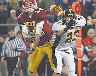 Cardinal Mooney's Ryan Farragher has the ball knocked away by Springfield Shawnee's Drew Young during the Division III state championship game Friday at Canton's Fawcett Stadium. The Cardinals held on for a 21-14 victory.