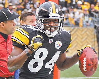 The Steelers' Antonio Brown celebrates after returning a punt for a touchdown during the second quarter against Cincinnati during Sunday's game in Pittsburgh. The Steelers routed their division rival 35-7.