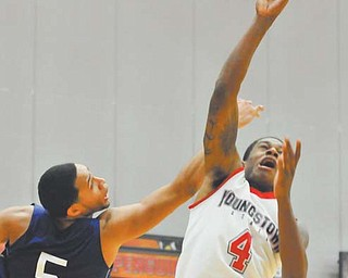 Youngstown State guard Shawn Amiker puts up a shot in front of Fredonia State's Julius Bryany during Tuesday's game at Beeghly Center. Amiker had three points off the bench in a 69-35 win.