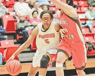 Youngstown State's Kenya Middlebrooks (5) dribbles the ball under the arm of Bowling Green's Chrissy Steffen during Tuesday's game at Beeghly Center. Middlebrooks scored 15 in the 73-61 loss.