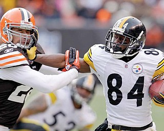 Pittsburgh Steelers wide receiver Antonio Brown (84) is pushed out of bounds by Cleveland Browns safety Sabby Piscitelli during their game on Jan. 2 in Cleveland. Pittsburgh has won 14 of the last 15 meetings between the rivals.