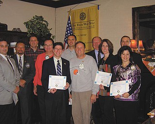 Thirteen members from the Rotary Club of Austintown recently received merit awards for perfect attendance during the first quarter. Shown above, from left to right: Vince Colaluca, Mark Cole, Brian Frederick, Ron Carroll, Dr. Mitch Dalvin, David Buttar, Gary Reel, Chuck Baker, Jennifer Connolly, Brian Laraway and President Deanna Spirko. Absent from the picture are Jerry Haber and Ram Kasuganti.