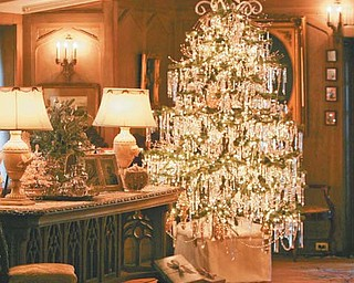 The library features a Christmas tree decorated with hundreds of new and antique glass and