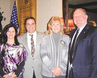 At a recent meeting of the Rotary Club of Austintown, Chuck Baker inducted new member, Tracie A. Kaglic, architect and project manager for the new school project. Her sponsor was Vince Colaluca. From left to right are Austintown Rotary President Deanna Spirko, Colaluca, Kaglic and Baker.