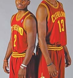 Cleveland Cavaliers rookies Kyrie Irving (2) and Tristan Thompson (13) pose for a photo during the team's media day Monday.