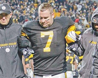Pittsburgh Steelers quarterback Ben Roethlisberger is helped off the field by a team trainer and backup quarterback Byron Leftwich after injuring his left ankle in the Steelers' 14-3 win over Cleveland. Roethlisberger has not practiced since the injury, and no decision has been made as to whether he will play in Monday's game against San Francisco.